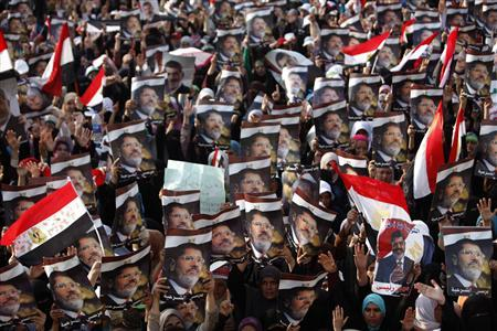 Women, who support deposed Egyptian President Mohamed Mursi, rally at the Rabaa Adawia square where they are camping in Cairo